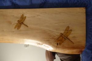 Dragon flies on carved frame