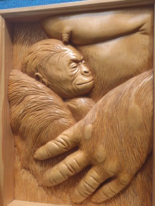 Relief carving mother wth baby